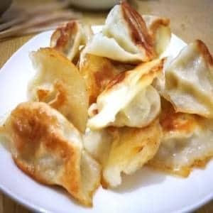 鉄の鍋深煎水餃子【煎水饺】